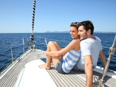 couple-sitting-tgoether-on-yacht